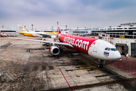 Bangkok, Thailand - April 29, 2016: AirAsia airplane in Don Mueang International Airport in Bangkok, Thailand. Its been named as worlds best low-cost airline, operates scheduled flights to 78 destinations