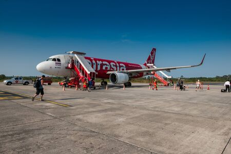 scheduled: Nakhon Si Thammarat, Thailand - April 27, 2016: AirAsia airplane in Nakhon Si Thammarat airport in Nakhon Si Thammarat province, Thailand. Its been named as worlds best low-cost airline, operates scheduled flights to 78 destinations