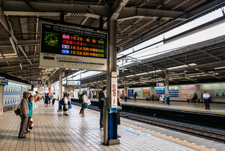 operated: Kawagoe, Japan - May 1, 2016: People waiting for train at Kawagoe Station. Kawagoe Station is a railway station in Kawagoe, Saitama, Japan, operated by the private railway operator Tobu Railway and East Japan Railway Company (JR East).