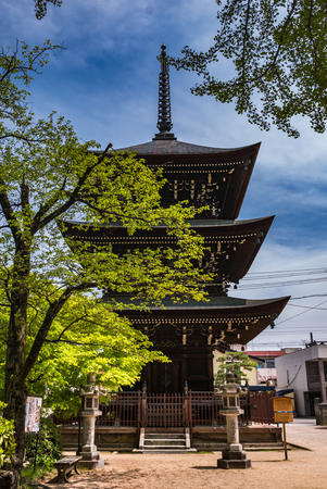 hida: Takayama, Japan - May 2, 2016: Three story pagoda at Hida Kokubunji Temple, Takayama, Japan. The Hida Kokubunji Temple was constructed in 746 by Emperor Shomu to pray for the nations peace and prosperity.