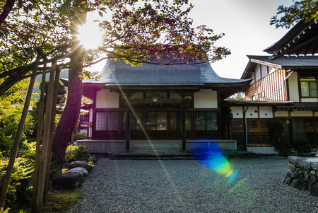 gassho zukuri: Shirakawa-go, Japan - May 2, 2016: Building with sun flare in Shirakawa-go. Shirakawa-go is one of Japans UNESCO World Heritage Sites located in Gifu Prefecture, Japan.