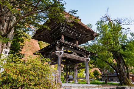 gassho zukuri: Shirakawa-go, Japan - May 2, 2016: Bell tower at the temple in Shirakawa-go. Shirakawa-go is one of Japans UNESCO World Heritage Sites located in Gifu Prefecture, Japan.