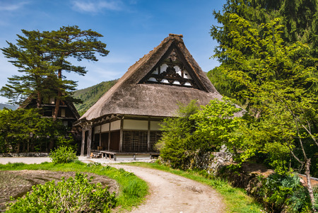 gassho zukuri: Shirakawa-go, Japan - May 2, 2016: Temple in Shirakawa-go. Shirakawa-go is one of Japans UNESCO World Heritage Sites located in Gifu Prefecture, Japan. Editorial