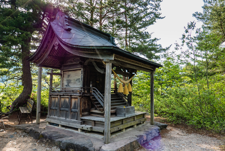 hida: Shirakawa-go, Japan - May 2, 2016: Shrine with sun flare at the view point of Shirakawa-go. Shirakawa-go is one of Japans UNESCO World Heritage Sites located in Gifu Prefecture, Japan. Editorial