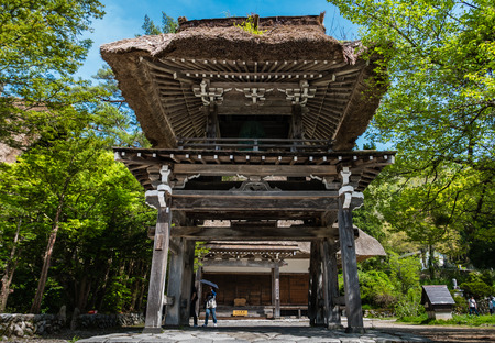 Shirakawa-go, Japan - May 2, 2016: Bell tower at the temple in Shirakawa-go. Shirakawa-go is one of Japans UNESCO World Heritage Sites located in Gifu Prefecture, Japan.