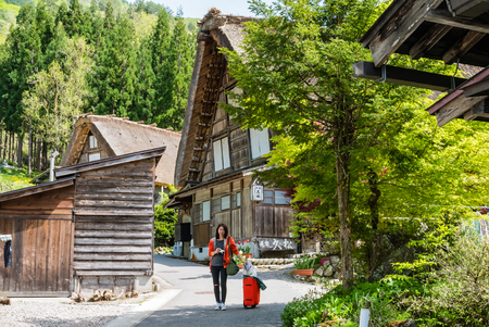 gassho zukuri: Shirakawa-go, Japan - May 2, 2016: Tourist visiting Shirakawa-go. Shirakawa-go is one of Japans UNESCO World Heritage Sites located in Gifu Prefecture, Japan. Editorial