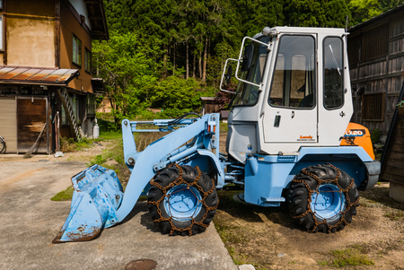 front end loader: Shirakawa-go, Japan - May 2, 2016: Front end loader in Shirakawa-go in Shirakawa-go. Shirakawa-go is one of Japans UNESCO World Heritage Sites located in Gifu Prefecture, Japan.