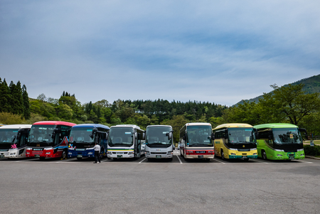 gassho zukuri: Shirakawa-go, Japan - May 3, 2016: Tourist buses parking in Shirakawa-go. Shirakawa-go is one of Japans UNESCO World Heritage Sites located in Gifu Prefecture, Japan.