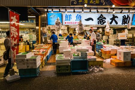 fish vendor: Kanazawa, Japan - May 3, 2016 : Vendor in Ohmicho Ichiba Fish Market in Kanazawa, Japan. It is the biggest fish market in Kanazawa. It selling all manner of freshly caught seafood.
