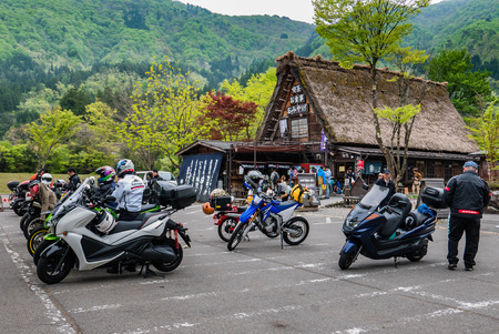gassho zukuri: Shirakawa-go, Japan - May 3, 2016: Tourists visiting Shirakawa-go. Shirakawa-go is one of Japans UNESCO World Heritage Sites located in Gifu Prefecture, Japan. Editorial