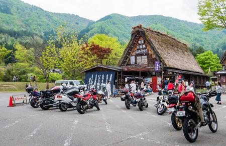 gassho zukuri: Shirakawa-go, Japan - May 3, 2016: Tourists visiting Shirakawa-go. Shirakawa-go is one of Japans UNESCO World Heritage Sites located in Gifu Prefecture, Japan. Editorial