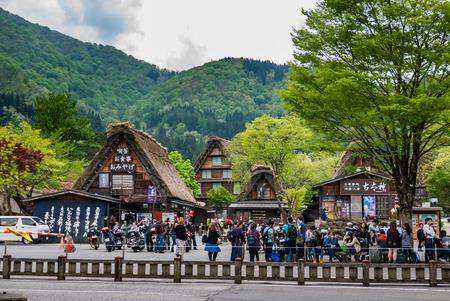 shirakawago: Shirakawa-go, Japan - May 3, 2016: Tourists visiting Shirakawa-go. Shirakawa-go is one of Japans UNESCO World Heritage Sites located in Gifu Prefecture, Japan. Editorial
