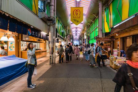 fish selling: Kanazawa, Japan - May 3, 2016 : People at Ohmicho Ichiba Fish Market in Kanazawa, Japan. It is the biggest fish market in Kanazawa. It selling all manner of freshly caught seafood.
