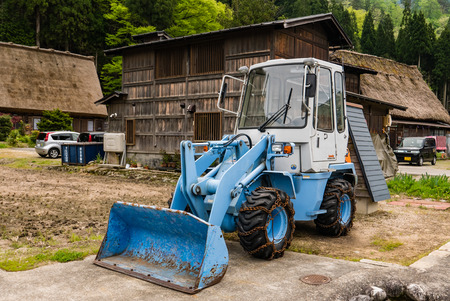 gassho zukuri: Shirakawa-go, Japan - May 3, 2016: Front end loader in Shirakawa-go in Shirakawa-go. Shirakawa-go is one of Japans UNESCO World Heritage Sites located in Gifu Prefecture, Japan. Editorial