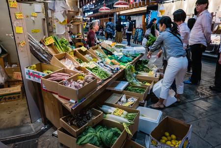 fish selling: Kanazawa, Japan - May 3, 2016 : Vendor in Ohmicho Ichiba Fish Market in Kanazawa, Japan. It is the biggest fish market in Kanazawa. It selling all manner of freshly caught seafood.