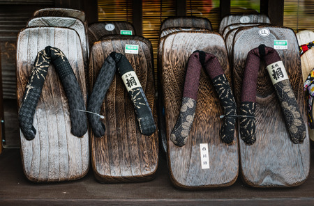 ryokan: Shirakawa-go, Japan - May 3, 2016: Japanese wooden sandals selling in souvenirs shop in Shirakawa-go. Shirakawa-go is one of Japans UNESCO World Heritage Sites located in Gifu Prefecture, Japan.