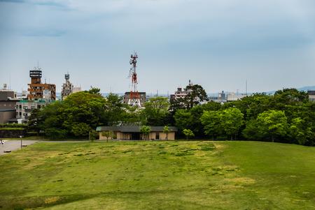Kanazawa, Japan - May 3, 2016: Green field in front of Kanazawa castle. Kanazawa Castle is a large, well-restored castle in Kanazawa, Ishikawa Prefecture, Japan. Editorial