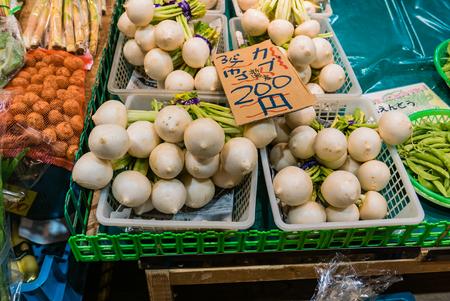 Kanazawa, Japan - May 3, 2016 : Vegetable shop in Ohmicho Ichiba Fish Market in Kanazawa, Japan. It is the biggest fish market in Kanazawa. It selling all manner of freshly caught seafood.