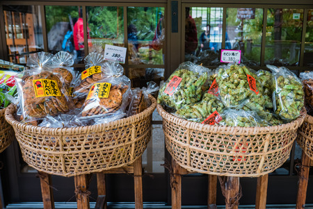 gassho zukuri: Shirakawa-go, Japan - May 3, 2016: Japanese snacks selling in souvenirs shop in Shirakawa-go. Shirakawa-go is one of Japans UNESCO World Heritage Sites located in Gifu Prefecture, Japan. Editorial