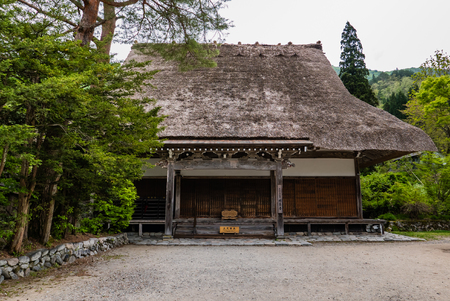 gassho zukuri: Shirakawago, Japan - May 3, 2016: Temple in Shirakawago. Shirakawago is one of Japans UNESCO World Heritage Sites located in Gifu Prefecture, Japan. Editorial