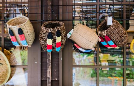 gassho zukuri: Shirakawa-go, Japan - May 3, 2016: Bamboo backpacks selling in souvenirs shop in Shirakawa-go. Shirakawa-go is one of Japans UNESCO World Heritage Sites located in Gifu Prefecture, Japan.