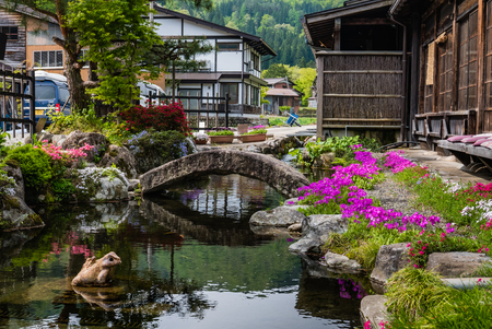 gassho zukuri: Shirakawa-go, Japan - May 3, 2016: Beautiful garden in Historical village of Shirakawa-go. Shirakawa-go is one of Japans UNESCO World Heritage Sites located in Gifu Prefecture, Japan.