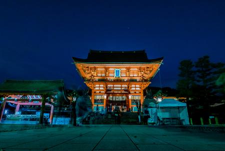 shinto: Kyoto, Japan - May 4, 2016: Fushimi Inari shrine at night. Fushimi Inari Taisha is the head shrine of Inari, located in Fushimi-ku, Kyoto, Japan.