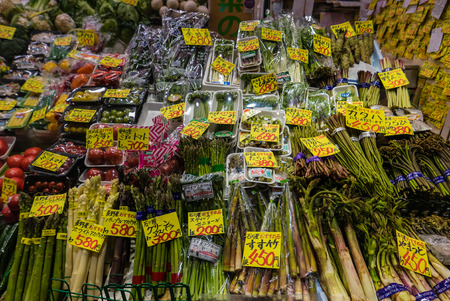 fish selling: Kanazawa, Japan - May 4, 2016 : Vegetable shop in Ohmicho Ichiba Fish Market in Kanazawa, Japan. It is the biggest fish market in Kanazawa. It selling all manner of freshly caught seafood.