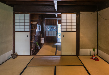 ishikawa: Kanazawa, Japan - May 4, 2016: Interior of the old wooden house in Higashi Chaya District (East Geisha District) in Kanazawa, Ishikawa Prefecture, Japan, known for tea houses where geishas perform since the 17th century.