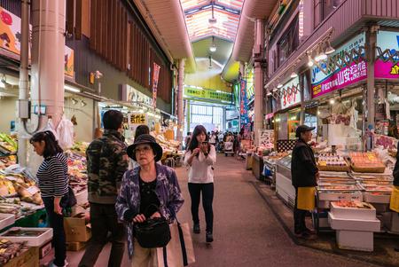 Kanazawa, Japan - May 4, 2016 : People at Ohmicho Ichiba Fish Market in Kanazawa, Japan. It is the biggest fish market in Kanazawa. It selling all manner of freshly caught seafood.