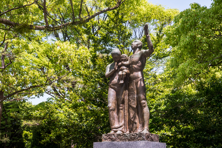 carry out: Hiroshima, Japan - May 5, 2016: Prayer Monument at Hiroshima Peace Memorial park. This monument was built on August 15, 1960 by the Committee to Carry out a National Festival of Prayers for Peace to Comfort the Spirits of the Dead. Editorial