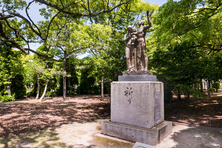 Hiroshima, Japan - May 5, 2016: Prayer Monument at Hiroshima Peace Memorial park. This monument was built on August 15, 1960 by the Committee to Carry out a National Festival of Prayers for Peace to Comfort the Spirits of the Dead. Editorial