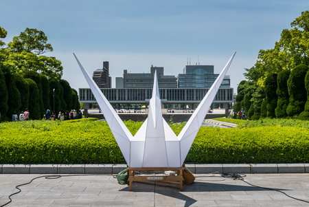 atomic bomb: Hiroshima, Japan - May 5, 2016: Origami model at Hiroshima Peace Memorial park. Hiroshima Peace Memorial Park  is a memorial park in the center of Hiroshima, Japan. It is dedicated to the legacy of Hiroshima as the first city in the world to suffer a nucl Editorial