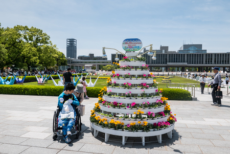 Hiroshima, Japan - May 5, 2016: Flower Candle message stand  at Hiroshima Peace Memorial park. Hiroshima Peace Memorial Park  is a memorial park in the center of Hiroshima, Japan. It is dedicated to the legacy of Hiroshima as the first city in the world t