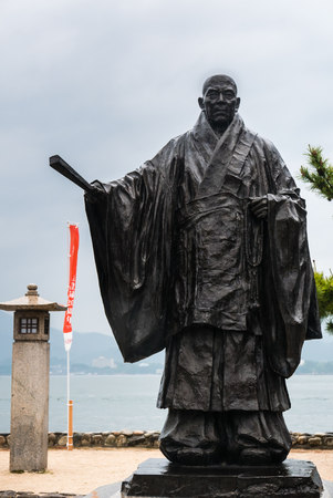 Miyajima, Japan - May 6, 2016: Statue of Taira No Kiyomori, 12th century military leader, at the shore of Miyajima Island. He was the benefactor of the Itsukushima Shinto Shrine. Editorial