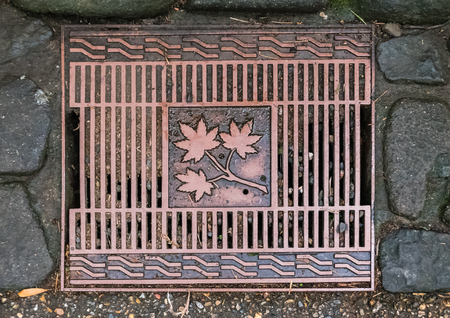 Kyoto, Japan - May 7, 2016: Manhole cover at Bamboo forest of Arashiyama, Kyoto, Japan. Arashiyama is a district on the western outskirts of Kyoto