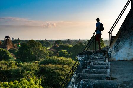 Bagan , Myanmar - October 21, 2016: Tourists enjoying the view of Bagan from the top of Shwesandaw Pagoda in morning in Bagan, Myanmar