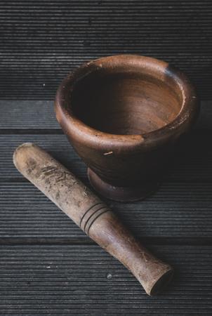 Mortar and pestle on wooden background 版權商用圖片