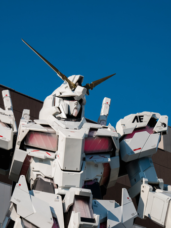 Tokyo, Japan - October 30, 2018: Full-size Mobile suit RX-0 Unicorn Gundam replica from the Mobile Suit Gundam Unicorn series at Diver City Tokyo Plaza in Odaiba, Tokyo, Japan