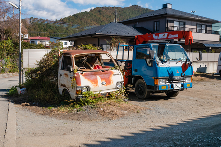 Kawaguchi, Japan - November 1, 2018: Old trucks near Kawagichiko lake, Yamanashi, Japan. Lake Kawaguchi is part of Fuji Five Lakes in Fuji-Hakone-Izu National Park
