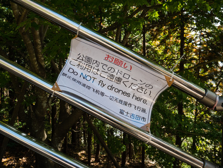 Kawaguchi, Japan - November 1, 2018: Do not fly drones sign near to Chureito Pagoda in Fujiyoshida, Yamanashi Prefecture. Editorial