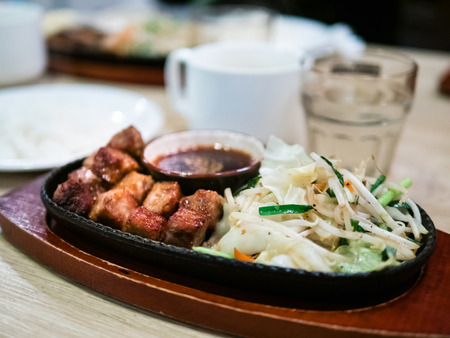 Japanese style diced beef steak served with vegetable on hot pan. Selective focus Stock fotó