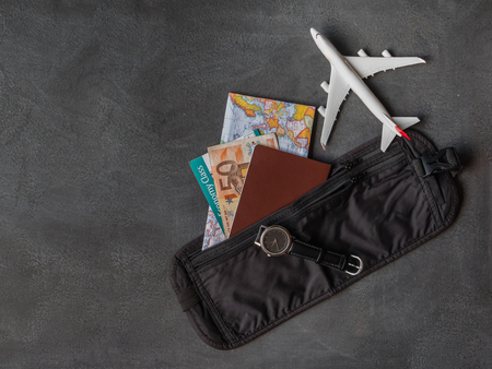 Travel concept - Money Belt with Passport, boarding pass and Euros