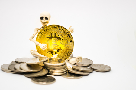Skeleton figure holding a golden bitcoin crypto currency.