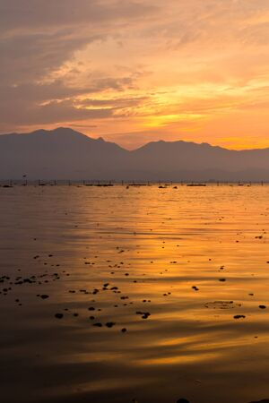 Sunset over the lake in Thailand Stock Photo