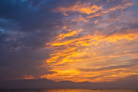 season specific: Season specific colorful dramatic sky in early evening Stock Photo