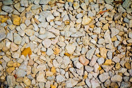 background made of a closeup of a pile of pebbles Stock Photo