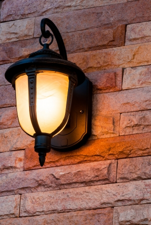 Vintage lantern on a wall photo