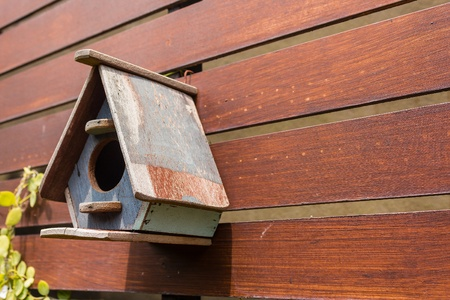 cute little birdhouses on wooden fence Stock Photo