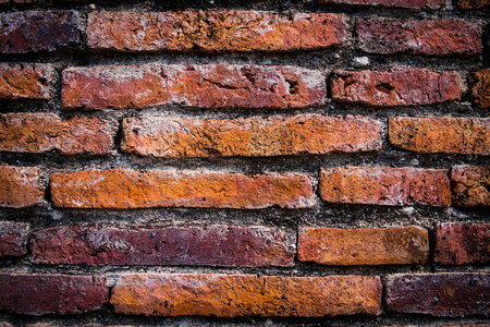 Old brick wall with dark corners - Stock Image